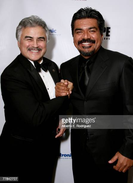 Pete Delgado CEO of LACUSC and comedian George Lopez pose for photos in the cocktail reception at the King of Hearts gala held at the Beverly Hilton...