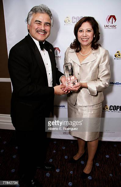 Pete Delgado CEO of LACUSC and Congresswoman Hilda Solis pose for photos at the VIP reception at the King of Hearts gala held at the Beverly Hilton...