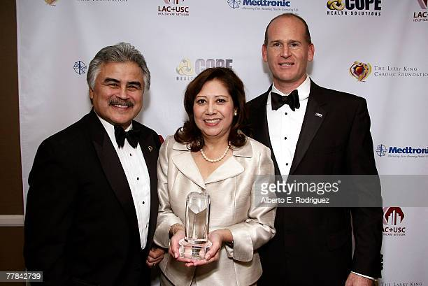 Pete Delgado CEO of LACUSC Congresswoman Hilda Solis and Allen Miller President and CEO of COPE Health Solution pose for photos at the VIP reception...