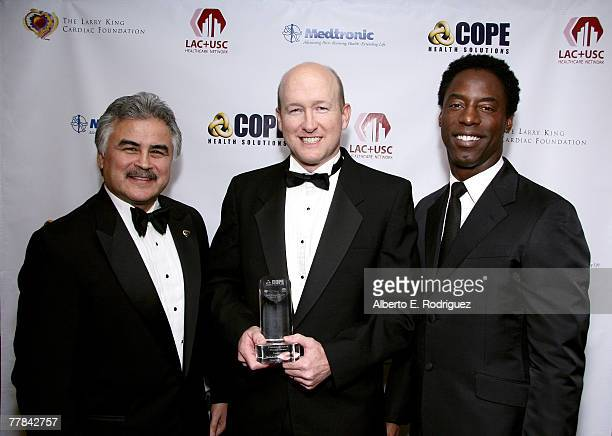 Pete Delgado CEO of LACUSC Paul T Giboney MD recipient of the Camino de Salud Partner Award and actor Isaiah Washington pose for photos in the...