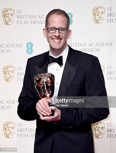 Pete Docter poses with the Best Animated Film Award for 'Inside Out' in the winners room at the EE British Academy Film Awards at the Royal Opera...