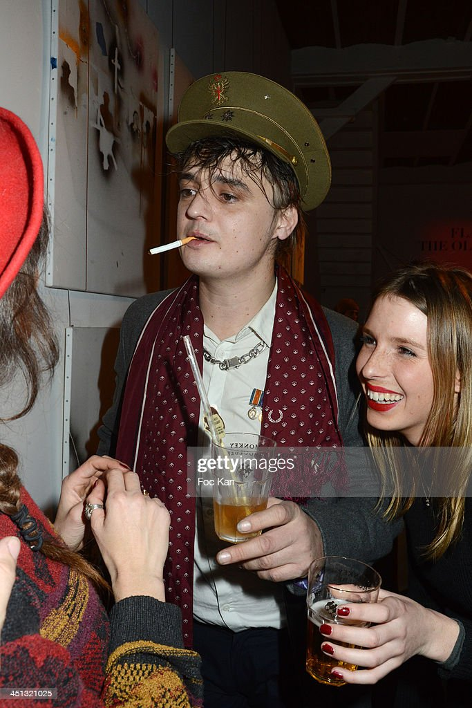 Pete Doherty and guests attend the 'Flags From The Old Regime' : Pete Doherty and Alize Meurisse Paintings Exhibition Preview At Espace Djam on November 21, 2013 in Paris, France.