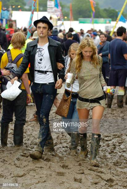 Pete Doherty and Kate Moss are seen on the third day of the Glastonbury Music Festival 2005 at Worthy Farm Pilton on June 25 2005 in Somerset England...