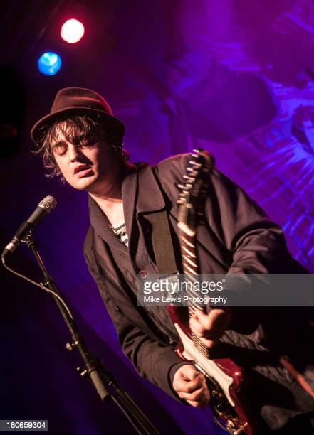 Pete Doherty of Babyshambles performs live on stage at Cardiff University on September 15, 2013 in Cardiff, Wales.