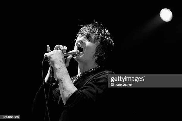 Pete Doherty of Babyshambles performs live on stage at O2 Academy Brixton on September 14, 2013 in London, England.