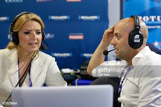Pete Dominick host of Stand Up with Pete Dominick on SiriusXM talks with Christine Romans of CNN while hosting his show at Quicken Loans Arena on...
