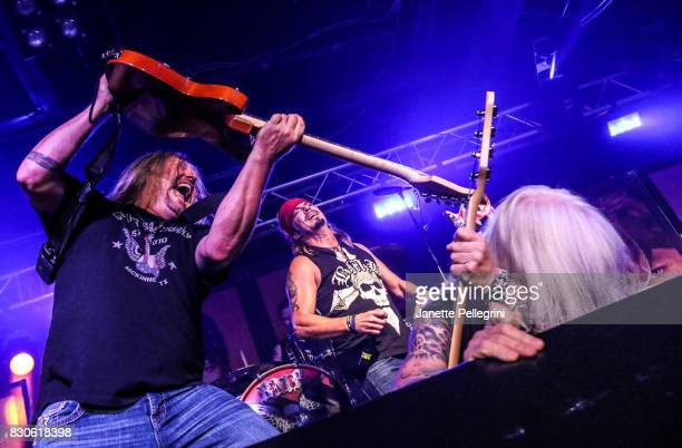 Pete Evick Bret Michaels and Eric Brittingham perform in concert on August 11 2017 at Mulcahy's Pub and Concert Hall in Wantagh New York