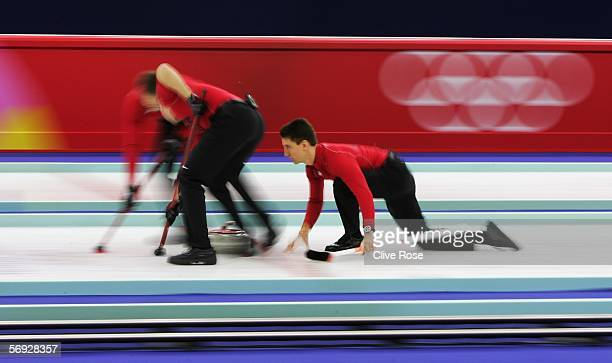 Pete Fenson of United States releases the stone during the bronze medal match of the men's curling between United States and Great Britain during Day...