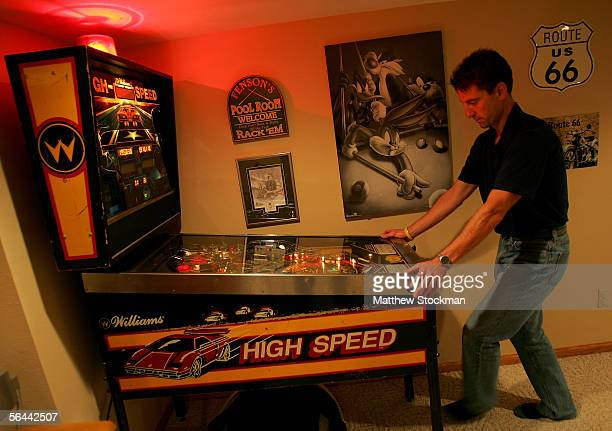 Pete Fenson plays pinball in his basement September 28 2005 in Bemidji Minnesota Pete Fenson is a curler and will represent the US at the Olympic...