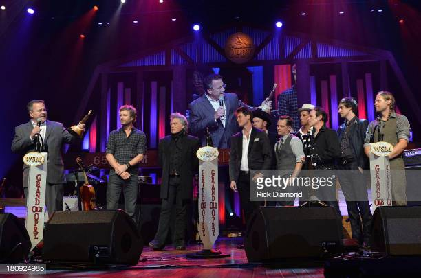 Pete Fisher GM Grand Ole Opry Opry Members Dierks Bentley and Marty Stuart induct Old Crow Medicine Show at The Grand Ole Opry on September 17 2013...