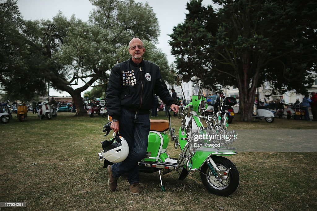 Pete Hinsley of the New Forset Scooter club stands besides his 1966 Lambretta SX 200 during the annual Isle of Wight Scooter Festival on August 25, 2013 in Ryde, England. The annual event, which is organized by the British Scooter Rally Association and The VFM Scooter Collective, attracts around 6000 riders each year and has been running since 1980. The scooter in 1960s Britain was a fashion statement and the often heavily customized bikes, usually an Italian Vespa or Lambretta, became synonymous with the Mod scene. They provided an inexpensive mode of transport and escapism to an upwardly mobile youth at a time when public transportation stopped early. The Vespa was depicted on the cover of The Whos Quadrophenia album in 1973.