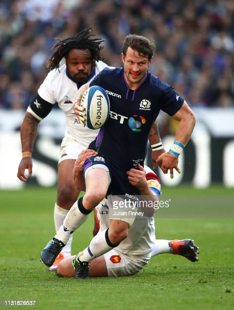 Pete Horne of Scotland is challenged by Louis Picamoles and Mathieu Bastareaud of France during the Guinness Six Nations match between France and...