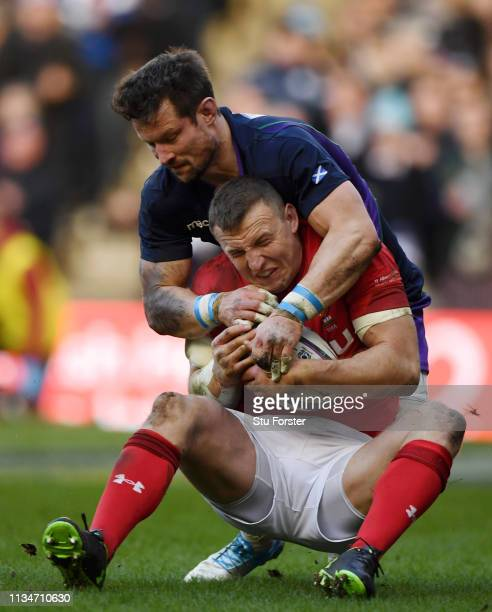 Pete Horne of Scotland tackles Hadleigh Parkes of Wales during the Guinness Six Nations match between Scotland and Wales at Murrayfield on March 09...