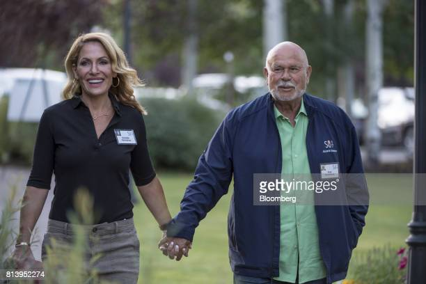 Pete Karmanos coowner and chief executive officer of the Carolina Hurricanes right arrives with his wife Danielle Karmanos for the morning session...