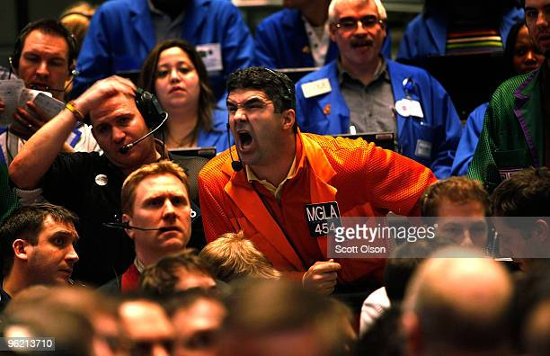 Pete Kosanovich yells an offer in the Eurodollar pit at the CME Group following the announcement from the Federal Open Market Committee that it would...