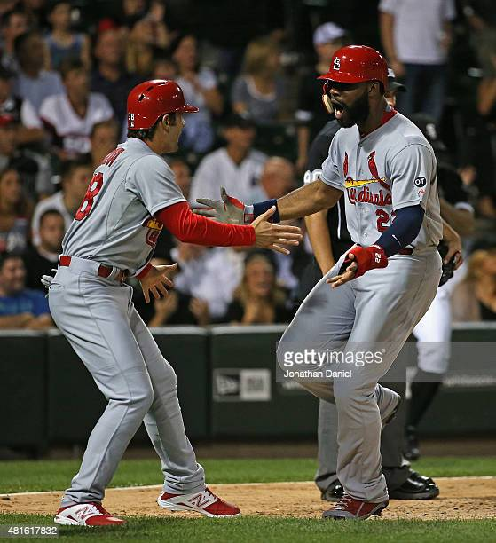 Pete Kozma and Jason Heyward of the St Louis Cardinals celebrate scoring runs in the 8th inning against the Chicago White Sox at US Cellular Field on...