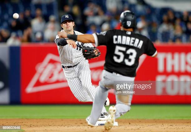 Pete Kozma of the New York Yankees completes an eighthinningending double play after forcing out Melky Cabrera of the Chicago White Sox at Yankee...