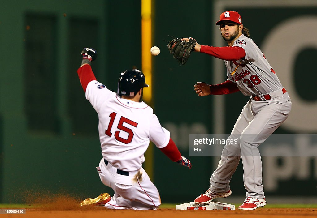 Pete Kozma #38 of the St. Louis Cardinals drops the ball as Dustin Pedroia #15 of the Boston Red Sox slides into second base during Game One of the 2013 World Series at Fenway Park on October 23, 2013 in Boston, Massachusetts.