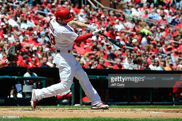 Pete Kozma of the St Louis Cardinals hits a single against the Philadelphia Phillies during the second inning at Busch Stadium on April 30 2015 in St...