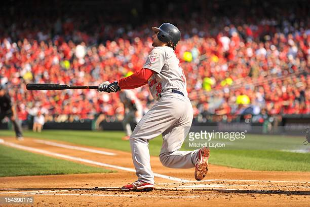 Pete Kozma of the St Louis Cardinals hits a three run home run during Game Three of the National League Division Series against the Washington...