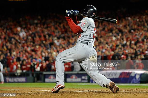 Pete Kozma of the St Louis Cardinals hits a two RBI single in the ninth inning to give the Cardinals a 97 lead against the Washington Nationals in...