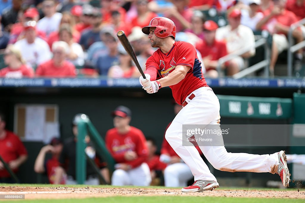 Pete Kozma #38 of the St. Louis Cardinals hits during the fifth inning of a spring training game against the Miami Marlins at Roger Dean Stadium on March 8, 2015 in Jupiter, Florida.