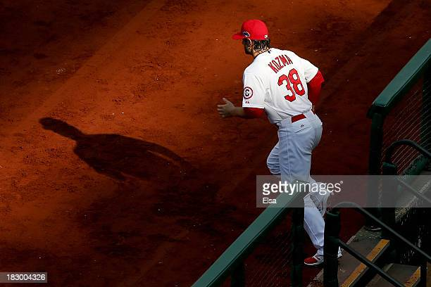 Pete Kozma of the St Louis Cardinals runs out to the first base line before taking on the Pittsburgh Pirates during Game One of the National League...