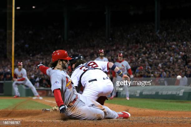 Pete Kozma of the St Louis Cardinals scores in the seventh inning against the Boston Red Sox during Game Two of the 2013 World Series at Fenway Park...