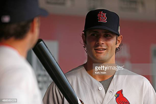 Pete Kozma of the St Louis Cardinals talks with Manager Mike Matheny of the St Louis Cardinals prior to the start of the game against the Cincinnati...