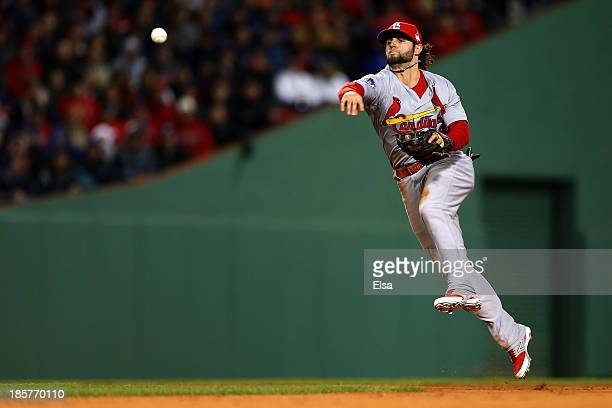 Pete Kozma of the St Louis Cardinals throws to first base in the seventh inning against the Boston Red Sox during Game Two of the 2013 World Series...