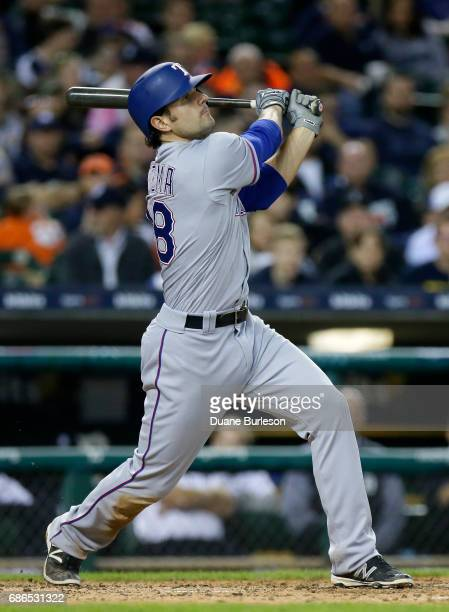 Pete Kozma of the Texas Rangers hits a solo home run against the Detroit Tigers during the sixth inning at Comerica Park on May 21 2017 in Detroit...