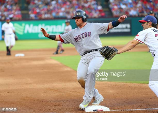 Pete Kozma of the Texas Rangers misses the tag in the second inning on Christian Vazquez of the Boston Red Sox at Globe Life Park in Arlington on...
