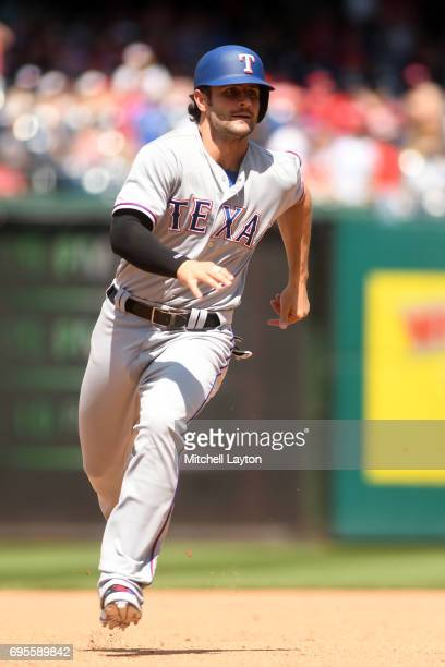 Pete Kozma of the Texas Rangers runs to third base during a baseball game against the Washington Nationals at Nationals Park on June 10 2017 in...