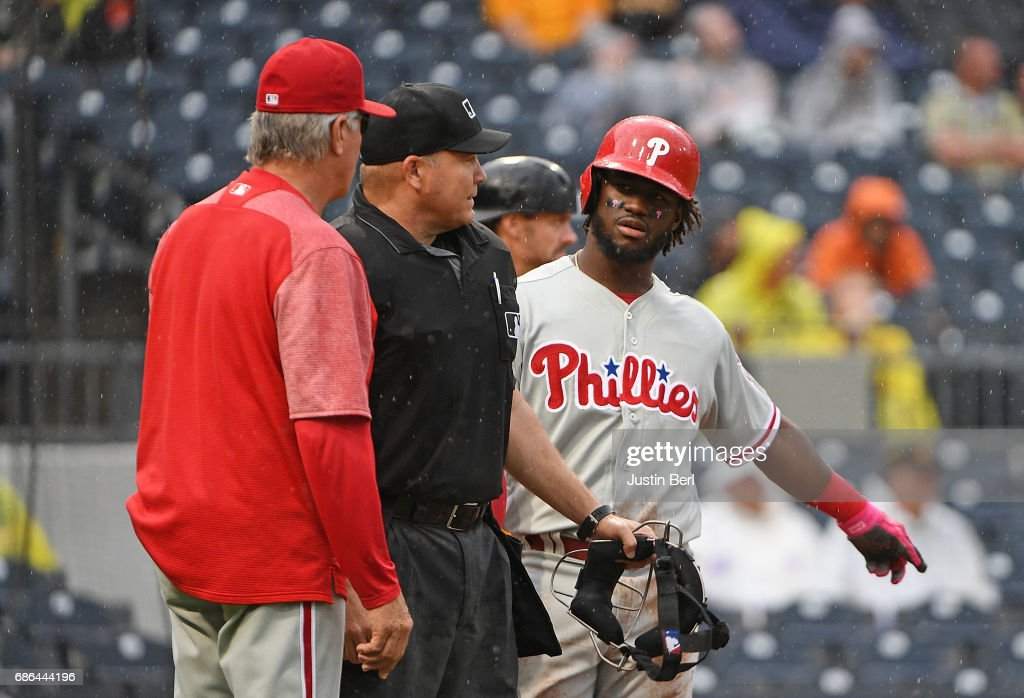 Pete Mackanin #45 and Odubel Herrera #37 of the Philadelphia Phillies question a call by home plate umpire Fieldin Culbreth in the ninth inning during the game against the Pittsburgh Pirates at PNC Park on May 21, 2017 in Pittsburgh, Pennsylvania.