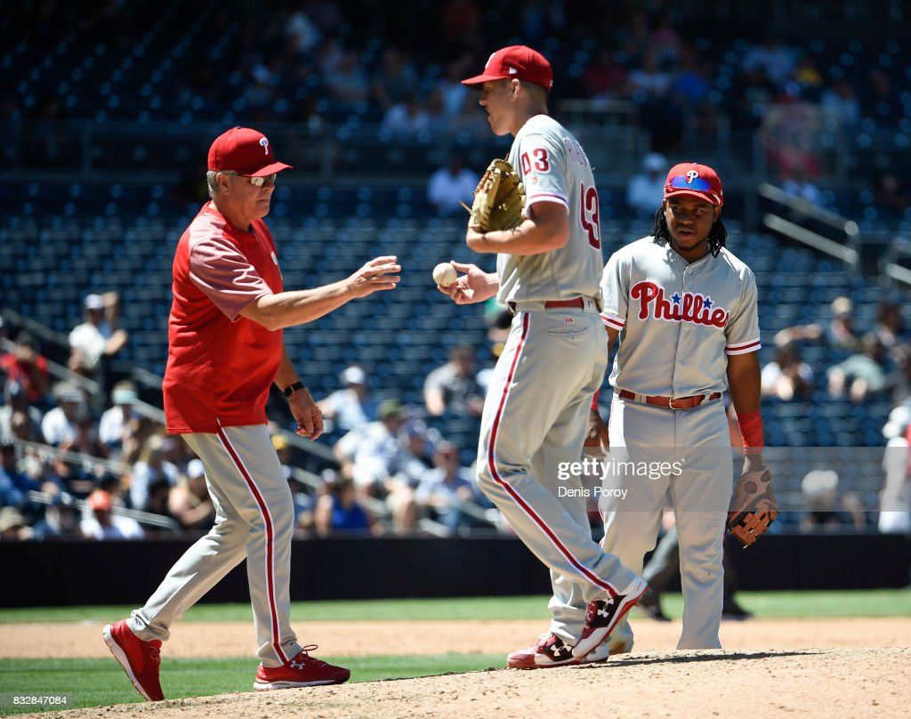 Pete Mackanin #45 of the Philadelphia Phillies, left, takes the ball from Nick Pivetta #43 as he leaves the game during the sixth inning of a baseball game against the San Diego Padres at PETCO Park on August 16, 2017 in San Diego, California.