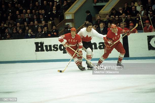Pete Mahovlich of Canada battles with Vladimir Vikulov and Gennady Tsygankov of the Soviet Union during the 1972 Summit Series at the Luzhniki Ice...