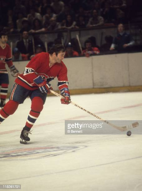 Pete Mahovlich of the Montreal Canadiens skates with the puck during an NHL game against the New York Rangers on December 12 1976 at the Madison...