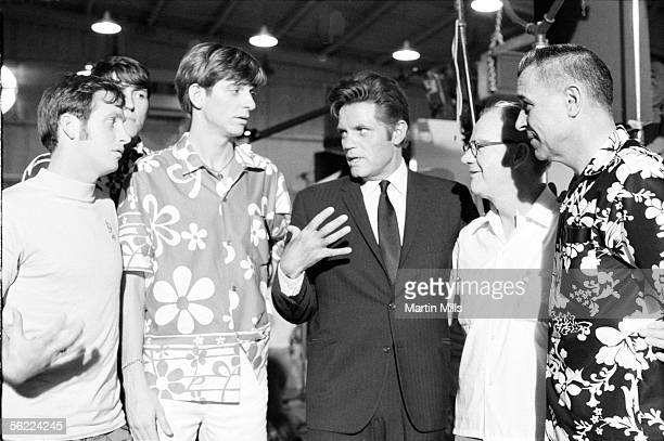 Pete Maravich of Louisiana State Tigers with teammates and his father coach Press Maravich visit actor Jack Lord on the set of Hawaii Five0 after the...