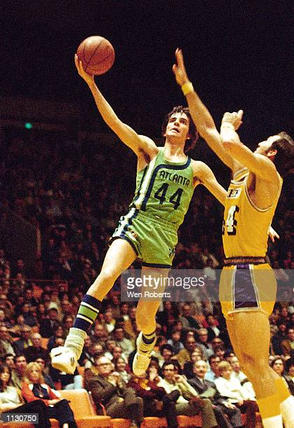 Pete Maravich of the Atlanta Hawks goes for a layup against the Los Angeles Lakers during a 1971 NBA game at The Forum in Los Angeles California NOTE...