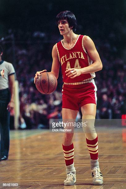 Pete Maravich of the Atlanta Hawks moves the ball up court against the Boston Celtics during a game played in 1974 at the Boston Garden in Boston...