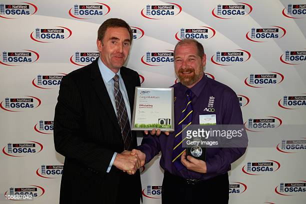 Pete Marshall is presented the Officiating Umpires and Scorers OSCA by Rob Bailey ECB First Class Umpire during the NatWest OSCAs at Lords on October...
