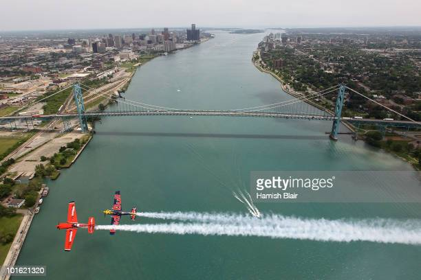 Pete McLeod of Canada and Kirby Chambliss of USA fly past the Ambassador Bridge during the Red Bull Air Race Training day on June 4 2010 in Windsor...