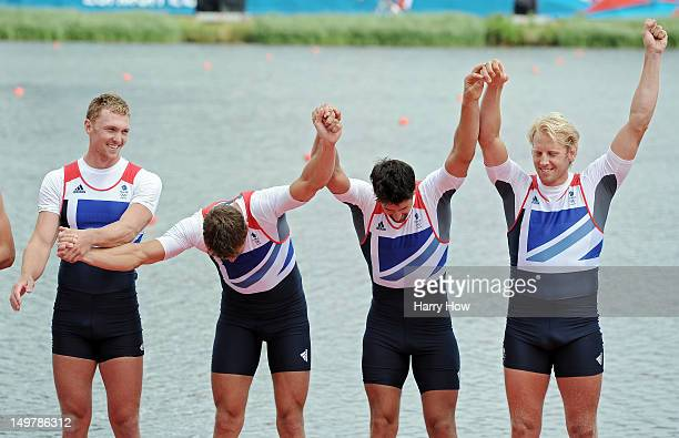 Pete Reed Andrew Triggs Hodge Alex Gregory and Tom James of Great Britain take a bow in front of the crowd before receiving their gold medals during...