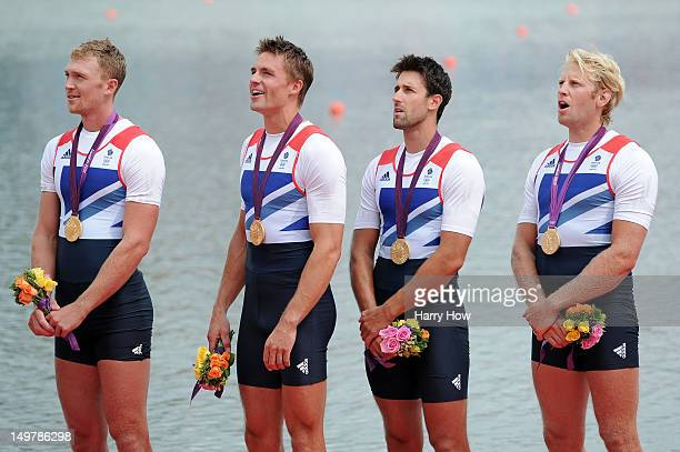 Pete Reed Andrew Triggs Hodge Alex Gregory and Tom James of Great Britain celebrate with their gold medals during the medal ceremony for the Men's...