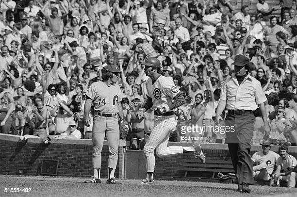 Pete Rose at first for Philadelphia looks the other way as Cubs' Dave Kingman rounds the bases in the sixth inning after hitting his third homerun of...