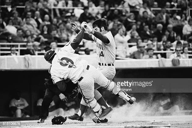 Pete Rose is tagged out at home as he slams into Mike Ryan who has caught Phils' Larry Bowa throw on Johnny Bench's grounder in the first inning of...