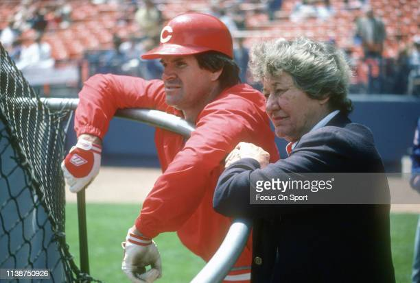 Pete Rose of the Cincinnati Reds and owner Marge Schott looks on during batting practice prior to the start of a Major League Baseball game against...