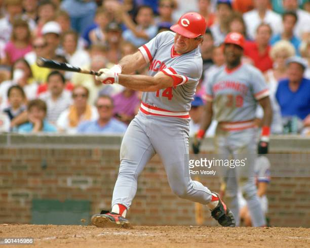 Pete Rose of the Cincinnati Reds bats during an MLB game against the Chicago Cubs at Wrigley Field in Chicago Illinois during the 1986 season