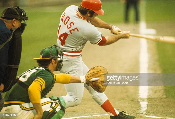 Pete Rose of the Cincinnati Reds hits the ball into the field during the World Series against the Oakland Athletics at OaklandAlameda County Coliseum...