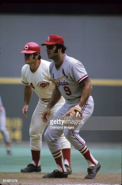 Pete Rose of the Cincinnati Reds leads off the base as firstbaseman Joe Torre of the St Louis Cardinals covers during a August 1973 season game at...